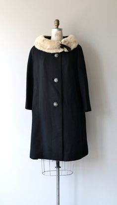 Vintage 1960s black wool coat with blonde mink collar set off with a small black bow, large domed silver filigree buttons, hip pockets and black silk