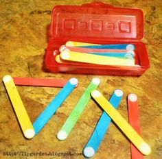 Turn simple craft sticks into a busy bag by adding velcro pieces. Each stick gets 4 velcro pieces at the ends – 2 fuzzy on one side, and 2 prickly on the other side.This is perfect for building shapes.