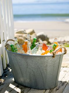 Cold Drinks in a Tub. The tub is paintable and can also be wrapped in ribbon or fabric or burlap even, really cute, with shells and starfish glued on. A nice beach look.