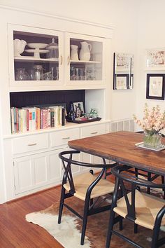 black wishbone chairs & a natural wood table
