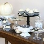 black and white halloween desserts table