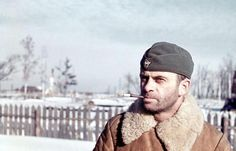 A German Feldjäger (Military Policeman) stops for a photograph during his smoke break in Finland