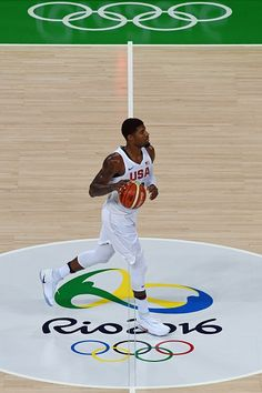 USA's guard Paul George dribbles during a Men's round Group A basketball match between USA and Venezuela at the Carioca Arena 1 in Rio…