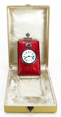 Faberge Clock Red Enameled Silver Gold Diamond Color Stone. Clock does not work,comes in original Faberge box.