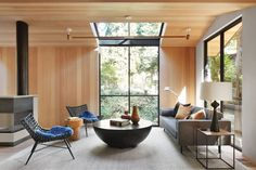 Walls and ceiling are paneled with hemlock, while flooring is European white oak. When a New York–based artist couple decided they needed an exurban getaway, they opted out of the usual suspects. No Hamptons, Hudson Valley, or Berkshires. Instead, they cast their net some 3,000 miles away and landed in Mill Valley, California, where they purchased a diminutive cottage. #interiordesign #architecture #getaways Square Side Table, Round Side Table, Sun Valley Bronze, Soapstone Kitchen, Cedar Siding, Kitchen Stools, Design Within Reach, Architect Design, A Boutique