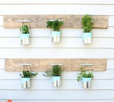 s 16 empty tin can hacks that will make your home look amazing, crafts, home decor, repurposing upcycling, Use painted cans for a hanging planter