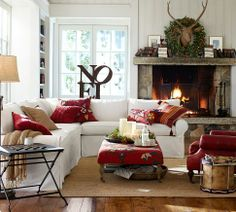 living room with red accents, especially love the embroidered pillows and ottoman (from Pottery Barn)
