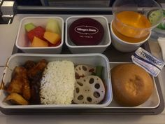 In flight dinner menu from Cathay Pacific, it's enroute from Hong Kong - Jakarta, Indonesia. In flight menu : fragrant rice with sauted lotus root and fish with black pepper sauce, fresh fruit and Haagen Dazs.