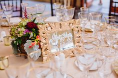 Custom made table number with Victorian Seaside inspired centerpiece at a Castle Hill Inn wedding reception in Newport, RI