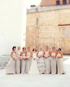 The Bridesmaids    Rachel Alvia of Avail & Co. designed the vintage-inspired silk-chiffon ball gowns with taupe underlays and blush-colored sashes. The eight custom dresses were designed and completed within four weeks.