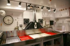 Once I own a home I will have someone remodel a permeant studio this organized. Beautifully orchestrated Darkroom