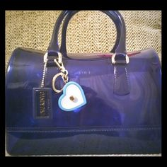 Furla Candy Handbag Excellent used condition,  comes with dust bag and Furla heart keychain, made of 100%PVC rubber, and has gold hardware, Royal blue color Furla Bags Totes