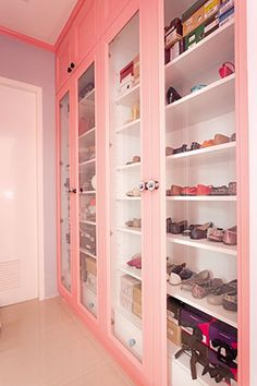 Shoes fit for a shopaholic are on-display for easy access in the walk-in closet. The closet follows the unit's overall palette.