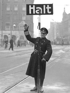 """1940 - 1945. During German occupation of the Netherlands signs were translated into German. In the photo: On this handheld road sign the Dutch word """"Stop"""" has been translated into German """"Halt"""". #amsterdam #worldwar2"""