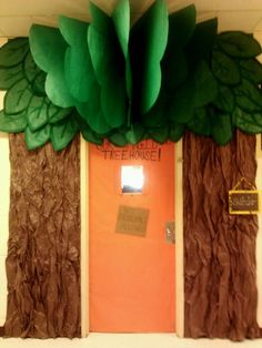 MAGIC Tree House:  Door entrance with brown butcher paper crumpled, green butcher paper for leaves around the top.  Add some 3D effect with leaves fanned and suspended.