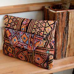 TCHAKPORI by NAWERI 129€ Boho clutch made from antique embroidered fabrics. Pochette confectionnée à partir de tissus brodés antiques. Modèle unique.