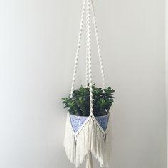 Macrame plant hanger with fringe