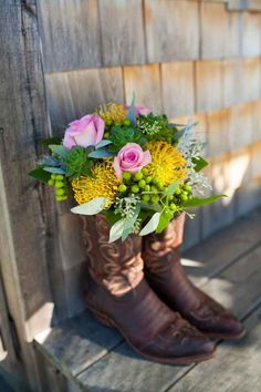 And use extra pairs of cowboy boots as decoration. | 24 Ways To Throw A Spectacular Country-Themed Wedding