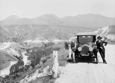 A man stands next to his Oldsmobile at 11th Avenue and B Street near City Creek Canyon, 1919. Courtesy Utah State Historical Society
