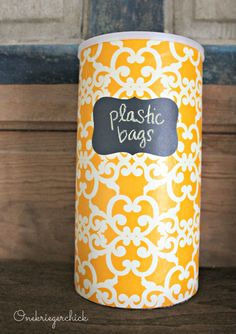 DIY plastic bag storage container {Onekriegerchick.com}  I also like the popcorn tin idea in this post - use one tin for bags, one for our umbrellas. Keep it all in the garage!