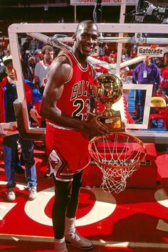 4d7e4de4bef900 Michael Jordan of the Chicago Bulls poses with the trophy after winning the  1988 Slam Dunk Contest as part of All-Star Weekend on February 1988 at  Chicago ...