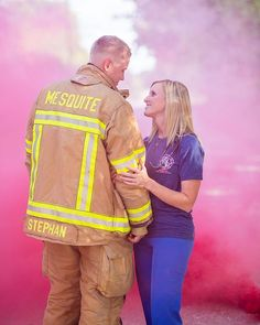 Smoke bombs, fire fighter, and a nurse make an amazing concept for their engagement shoot.
