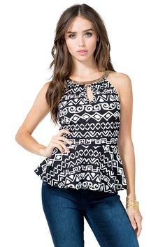 A monochromatic peplum top featuring an allover tribal-inspired print and metal plated detail in the front. Self-tie halter neck. Sleeveless. Front keyhole cutout. Finished hem. Looks amazing with dark skinny jeans and heels. $20.50