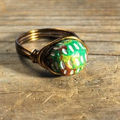 Colorful green, red, white, and yellow Clay beaded, antique brass gold wire wrapped wrap ring