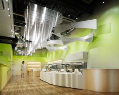 –Unity under the luminous aura of milk–  The following interior design was realized for a retail store of a company which runs its own dairy farm, featuring products, such as dairy products, sweets and bread, made using milk form said farm as th