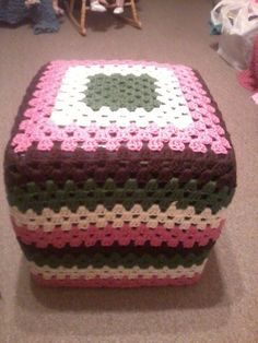 this was half of a dice set, a black stool with white buttons for the spots, it didnt match my decor so I made this to cover, didnt have a pattern! the colors or rose,medium thyme,cream, and brown, Now it matches!