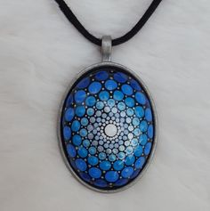 "Marine mandala necklace ""we're back with Fabulous necklaces for sale"" #handmade #mandalas #mandalaart #handmadenecklace #mandalanecklace #mandala #handmadejewelry #handmadeaccessory #dotting #polymerclay #polymerclayjewelry #ventagejewelry #paintingmandalas #inspiredjewellery #creativejewellery"