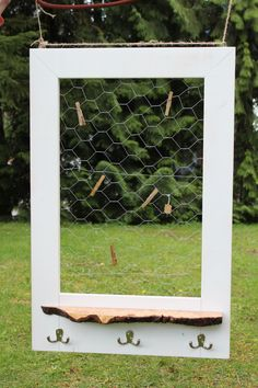 rustic white chicken wire frame with maple burl shelf and hooks.
