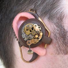 """Steampunk Bluetooth aka mechanical aural communication device from Chris from Chicago, a.k.a. Flickr member nicrosin, is the creator behind this fun and cool looking piece of art. """"I created this prop from sculpey, rubber, and a various pocket watch parts. The prop is fully adjustable and flexible and I lined the inside part with suede leather for comfort."""""""