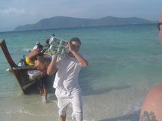 Fabrice getting the important things on board first to a function on a deserted Island