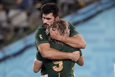 South Africa's Faf de Klerk celebrates with Damian de Allende after scoring a try during the Rugby World Cup quarterfinal match at Tokyo Stadium between Japan and South Africa in Tokyo, Japan, Sunday, Oct. (AP Photo/Jae C. Go Bokke, First World Cup, Six Nations, Rugby World Cup, Rugby Players, Under Pressure, Sport Man, Cuddles