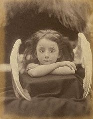 Julia Margaret Cameron   British, Freshwater, Isle of Wight, 1872   Albumen silver print  Young Rachel Gurney's forlorn expression does not quite fit her role as an angel, but in a humorous way, her performance supports this photograph's staged look. She is perched on a box that is covered loosely in drapery and positioned stiffly on a table, with fake wings attached to her. Resting her chin on her crossed arms, she appears resigned to her fate of posing for the camera.