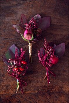 Fall-themed boutonnieres - love the red berry color