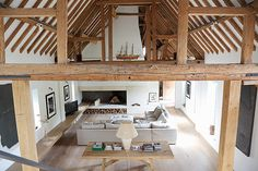 Barn conversion in Oxfordshire contemporary white space, double height ceiling exposed timber