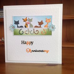Penny Black FeLINE die cut, Tattered Lace words and all coloured with Distress Inks.