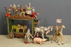 Schoenhut Circus Parade Wagon with Schoenhut performers on it.