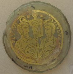 Jesus crowns Peter and Paul with laurels. Both are depicted in togas as Roman citizens.