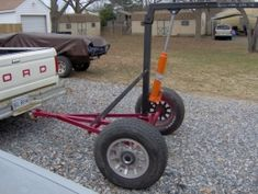 Towed Hoist - Homemade towed hoist constructed from an axle, wheels, square tubing, hitch, and an engine hoist.