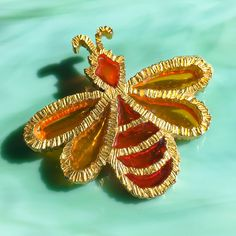 This large and colorful vintage 1970s 2-tone orange & amber gold-tone figural bumble bee pin / brooch is very well-made and doesnt sting! Shes in fantastic vintage condition and would make the perfect gift for your favorite bee enthusiast. New items are added daily so I hope youll come back to visit Figurally Speaking again soon: http://www.figurallyspeaking.etsy.com Thank you for stopping by. :-) PS - If youre looking for romantic vintage rhinestone jewelry, check out ...