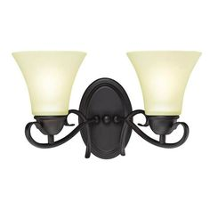 We love the delicate swirls of this classic wall fixture   Dunmore Two-Light Wall Fixture   Oil Rubbed Bronze Finish with Frosted Glass