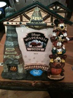 DISNEY WORLD WILDERNESS LODGE FIREPLACE PHOTO FRAME.  LOVE COLLECTING DISNEY FRAMES.  Most of our house is filled with our Disney vacations.  At last count my kids counted over 120 pictures.  Can you say OBSESSED!!!!