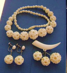 Antique set (parure) with ivory: necklace, earrings and brooch with carving puzzle ball.