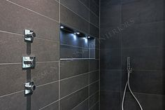 Feature anthracite tiles and thermostatic designer Axor shower
