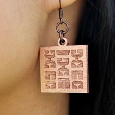 A pair of earrings were made by combining the serif counter-forms of letter 'E's. Boldly show your appreciation for the negative space found in typography.    These earrings will gleam boldly against the skin of the affectionate type-lover.    Made with <3