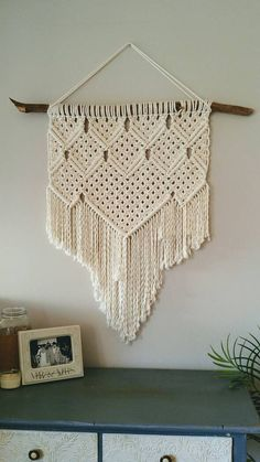 This Piece is made with off-white 100% cotton cord. Dimensions: The macrame piece measures approximately 23 x 33. This does not include the dowel.  Please note that most pieces are made to order, therefore the dowel look and size may vary.  Local pick up is also available, please visit the shop to find the local pick up listing.  Let me know if you have any questions or custom requests.  Thank you