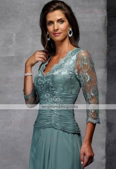 Beautiful colour of the dress. Ruched bodice and lace.